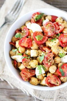 Chickpea, Pesto, Tomato, and Mozzarella Salad Recipe on http://twopeasandtheirpod.com Only 4 ingredients needed to make this healthy salad! #salad #vegetarian