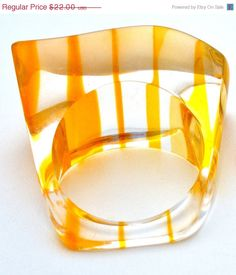 Vintage Striped Lucite Boho Ring Size 8 Yellow  Stylish striped lucite ring  Top of the ring setting measures 5/8 x 1 1/4  Size 8  Has a