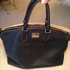 Dooney and Bourke This black bag has a pebble grain leather. Supersoft. High-end luxury looking. Exterior and Interior in excellent condition! Dooney & Bourke Bags Satchels