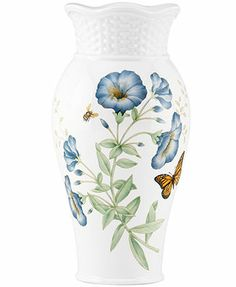 Add a beautiful touch of springtime to your decor with the Lenox Butterfly Meadow Basket Vase. Crafted of white porcelain, this accent piece features a colorful butterfly and floral motif to evoke the whimsical beauty of butterfly meadows. Lenox Butterfly Meadow, Blue Butterfly, Butterfly Wings, Lenox Vase, Lenox China, Living Room White, Living Rooms, Wood Vase, Crystal Vase