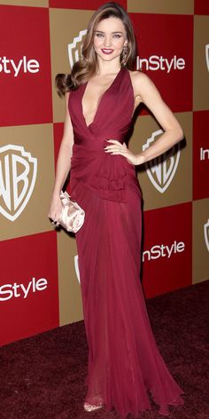 At the InStyle Golden Globes bash, Miranda Kerr in a burgundy Zuhair Murad gown. Strappy sandals and a satin clutch from Ferragamo and colorful H.Stern jewels completed the look.