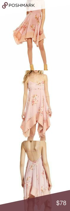 """NWT FREE PEOPLE FLORAL HANDKERCHIEF HEM DRESS NWT BEAUTIFUL FREE PEOPLE FLORAL HANDKERCHIEF HEM DRESS 26"""" center front length; 33"""" back length (size Medium ) Slips on over head Rounded V-neck Adjustable straps Empire waist Fully lined 100% viscose  I ONLY HAVE 1 SIZE LARGE & 1 SIZE MEDIUM IN PINK Free People Dresses"""