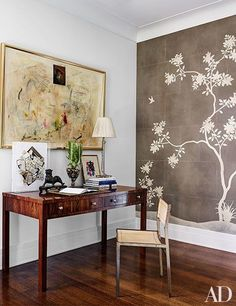 A study area in a master bedroom displaying an acrylic-encased collage by Robert Briggs | archdigest.com
