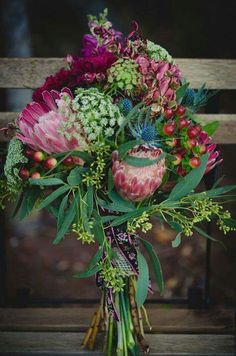 Bridal bouquet with protea, queen anne's lace, coffee bean, and seeded eucalyptus