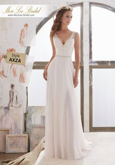 Style AXZA Marjorie Wedding Dress  Simply and Elegant, This Georgette Sheath Gown Features an Embroidered Bodice with Illusion Side Insets and Crystal Beaded Trim. Deep V Neckline and Back. Colors Available: Diamond White, Ivory/Nude. Shown in Ivory/Nude.