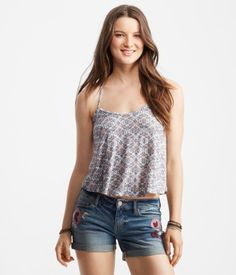 """You're destined for the limelight in this Cape Juby Vintage Tile Lace-Back Swing Tank! It's adorned with an intricate pattern of scrolls, dots and floral inspired shapes, while lace detailing decorates the back. Pair it with chunky bangles and shine on, girlfriend!<br><br>Relaxed fit. Approx. length (S): 15.25""""<br>Style: 5171. Imported.<br><br>96% rayon, 4% spandex.<br>Machine wash/dry flat."""