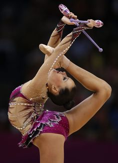 Uzbekistan's Ulyana Trofimova performs during the rhythmic gymnastics individual all-around qualifications at the 2012 Summer Olympics, Friday, Aug. 10, 2012, in London.