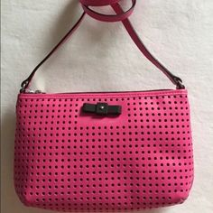 """Marc by Marc Jacobs Sophisticato Perforated Bag Our favorite detail on this cross-body bag from Marc by Marc Jacobs? The dainty but linear bow that sits at the front, lending feminine charm to the graphic look of the perforated leather - Pink perforated leather, black bow at front, zipped top and a slender crossbody strap.  ·      Leather ·      Crossbody strap ·      Top zip closure ·      Lined ·      Interior slip pocket ·      9.75"""" L x 6.5"""" H x 1"""" W ·      23"""" strap drop Marc by Marc…"""
