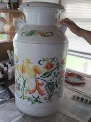 painted milk cans in white with flowers