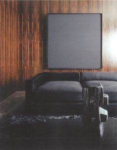 This room is so straight-forward. The black monotone is a great contrast to the beautiful panelling. Tom Ford's Study with Ad Reinhardt Painting, London, February 2004.