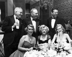 Marion Davies and some friends  Left to right - (seated) Mrs Arthur Lake (Patricia Van Cleeve, Marion's daughter with WR Hearst), Marion Davies, and Mrs Huntington Hartford (Marjorie Steele), and (standing) Douglas Wood, Captain Horace Brown, and Arthur Lake. photo dated - January 30, 1953
