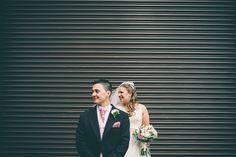 Bride & Groom against corrugated iron door. Guisborough Hall Wedding, Stockton on Tees.