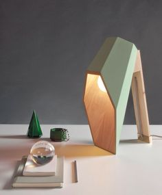 Woodspot Table Lamp - Desk Lamps, Wood Lamps - Woodspot by designer Alessandro Zambelli. The lamp is made in Pine wood with natural finish and assembled and varnished entirely by hand. The diffuser is available in ivory white, flesh … Read Deco Luminaire, Luminaire Design, Wooden Desk Lamp, Blitz Design, Study Lamps, Futuristic Interior, Futuristic Furniture, Wood Design, Design Design