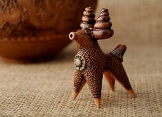 Penny whistle in the form of lamb made from by ZholubakEcoCeramics