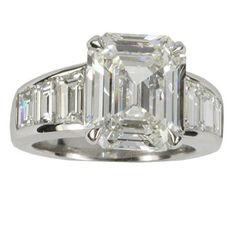 Amazing Platinum 6.01ct Emerald Cut Diamond and 6 Trapezoid shaped Diamonds 2.12ctw.