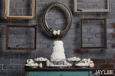 hang vignette of empty frames from the ceiling in front of the wall instead of on the wall