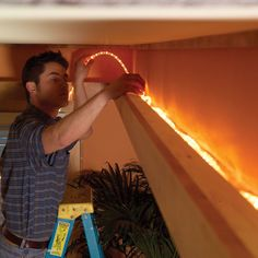 Add drama and beauty with this easy-to-build soffit lighting system and well-placed lighting. This is the ultimate improvement for ordinary ceilings. Installing Recessed Lighting, Recessed Ceiling, Bedroom Lighting, Home Lighting, Room Lights, Ceiling Lights, Soffit Ideas, Diy Wood Wall, Ceiling Installation