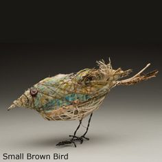 Artist, Bryant Holsenbeck, makes these beautiful animal sculptures with recycled objects and fabrics.