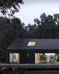 What do you think about this design? The Forest House is designed and visualized by Anastasiia Sholopova and is located in Ukraine Cabin Design, Roof Design, House On The Rock, House In The Woods, Black House Exterior, Modern Barn House, Modern House Design, House Cladding, Forest House
