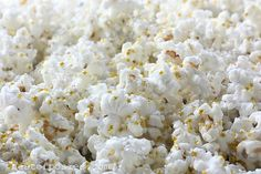 New Year's Eve POP! Corn.  Popcorn with white chocolate & edible glitter stars & silver pearlized sprinkles.  Blogger pinned recommends using Orville Redenbacher's Tender White Popcorn & says it really makes a difference.