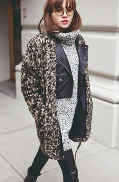 Natalie off Duty in a retro leopard coat and round sunglasses