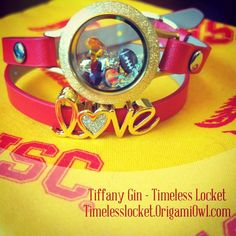 My USC Trojans collage game day look. We're in  Arlington Texas today to watch USC take on Alabama.  This Origami Owl look is using our  red leather wrap and our limited edition gold glitter face wrap base and love slider.  Fight On USC!! #usctrojans #gameday  #Team Gin #timelesslocket #usc #OrigamiOwl #universityofsoutherncalifornia #beatthetide # # #cardnalandgold #socal