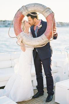 Private yacht at Balboa Bay Resort. Her gown is by Kirstie Kelly and his suit and tie is courtesy of Bonobos. // Photo Jen Huang Photography