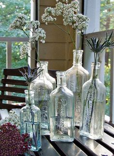 simple baby's breath and vintage bottles ( i like the other pins with vintage buttons; and adding pink roses; and a ribbon on the bottle)