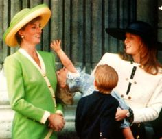 Princess Beatrice trying to grab her Aunt Diana's hat while Sarah and Prince William look on 1991