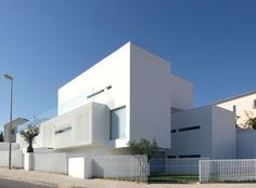 Located in Alto do Lagoal, a neighborhood facing the sea in Lisbon, Portugal, the home sits nicely between two blues: the sky and sea. The House at Paço de Arcos by Jorge Mealha, unfolds a setting where solids and voids are in display for each other.
