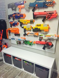 19 Unique Toy Storage Ideas for Kid's Playroom, Bedroom & Small Space Living Room 2019 Nerf Wall Nerf Gun Storage, Kid Toy Storage, Storage Ideas, Wall Storage, Children Storage, Storage Organization, Storage Bins, Wall Shelves, Stuffed Toy Storage