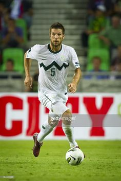 slovenian-footballer-bostjan-cesar-runs-during-the-uefa-euro-2012-c-picture-id124000290 (682×1024)