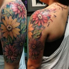 http://www.tattoosmob.com/wp-content/uploads/2013/06/Half-Sleeve-Girly-Flower-Tattoo.jpg  maybe something like this, but without the loose petals and much brighter colors and i am thinking something else between them either with or besides the leaves