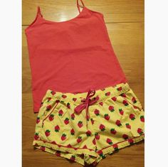 Pajama set - sleep shorts and cami Very cute sleep shorts with strawberry design and red cami. Cami is size large and the shorts are a medium, but run large. Very cute pj set and in good condition. Old Navy Intimates & Sleepwear Pajamas