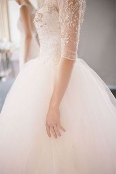 Delicate Lace Sleeves and Soft Tulle Skirt | I definitely want a dress with sleeves sort of like this; half-sleeves, semi-see-through.
