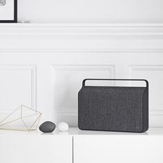 A handsome, Danish-designed wireless speaker, made from a die-cast aluminum frame & Kvadrat fabric facing.