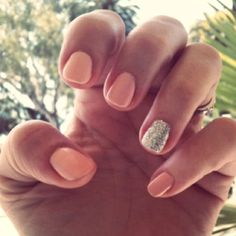 Peach nails with a shiny ring finger nail!  Love this.