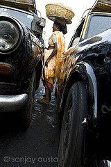 Between the taxis, Mumbai (sanjayausta) Tags: street woman india fish photography dock asia fishermen market bazaar mumbai fishmarket metropolitan sanjay colaba fisherwoman austa sasoon