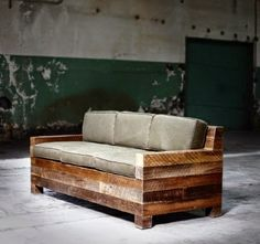 wooden sofa! from 4''x4''s. must weigh a ton, but I love it! tell me there is storage beneath those cushions...