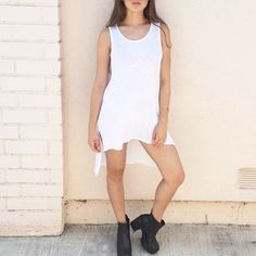 """High Low Slit Tank Dress Pick up this new trend now! Brand new simple long tank with the rounded cut hem. High low style dress. Open sleeves. Stretch material.    Model is wearing a small. Selling a medium. Height: 5'3 Bust: 33.5"""" / Waist: 26.5"""" / Hips: 30.5"""" 50% Cotton 50% Modal  No trades. I ship daily Mon to Fri. Bundle 2+ items for a discount. Offers considered through the Offer option. Xo, @dasrozo 