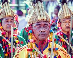 Jingpo (景颇族) men at a festival celebrating their heritage in Yunnan province China. Yunnan has a large amount of ethnic and cultural diversity. It's a fantastic region of China to explore.