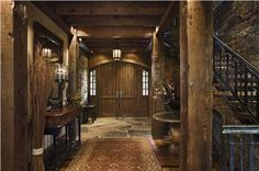 Dark Country/Rustic Foyer by Jerry Locati