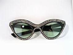 fd6ce37ec3 Vintage glam cat eye sunglasses. Rhinestone studded oversized 1950s black  plastic frames. Tinted non-prescription lenses.