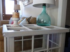 DIY -- Table made from old windows, this is a great idea if you don't have young children around. Like this idea.
