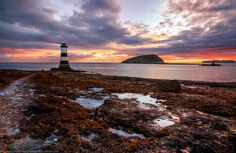 Sunrise over Penmon Lighthouse, Puffin Island and the Great Orme, Anglesey, Wales