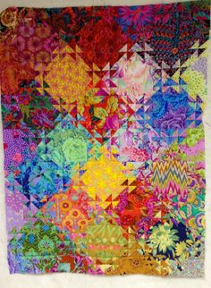 Shimmering Triangles - not a tutorial but enough information to figure it out on your own. Read all the blogs on this quilt.
