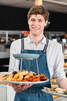 The crew at Watergrill Restaurant offer fabulous seafood platters with exquisite waterfront views - the perfect beachfront dining experience ⭐️ The team fit beautifully into the venue in a nautical uniform of Barkly Denim Aprons with Striped Straps ⚓️ | Coastal Venue Decor | Restaurant Design Ideas | Seafood Restaurant Uniforms Restaurant Offers, Seafood Restaurant, Restaurant Design, Denim Aprons, Restaurant Uniforms, Seafood Platter, Nautical, Coastal, Design Ideas