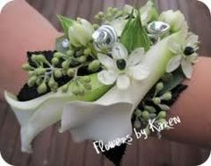 Calla lily wrist corsage - we could do something similar to this, but with simpler foliage decoration.