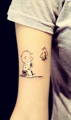 Snoopy tattoo - Okay, so this would possibly be a tattoo that I would get.