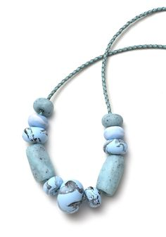 This necklace is part of the Marmo range and features eleven hand-formed ice blue toned marble patterned and speckled polymer clay beads. The be...